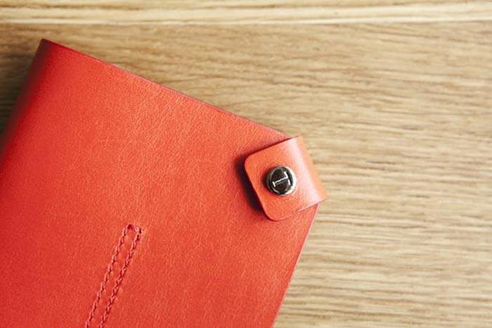 Pochette pour passeport Tods et Monocle rouge