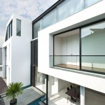 Maison design par Park + Associates-Piscine