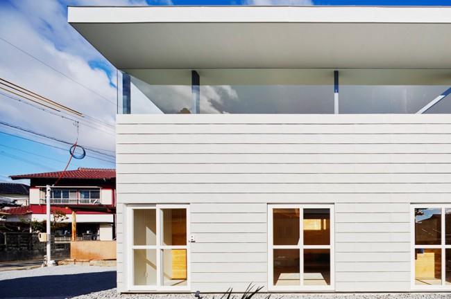 Maison bardage blanc